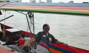 Happy long boat driver