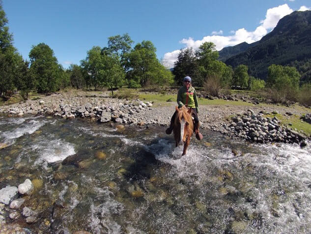 Horse riding river crossing Pucon