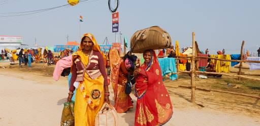 Friendly female travellers at the kumbh Traveling Honeybird
