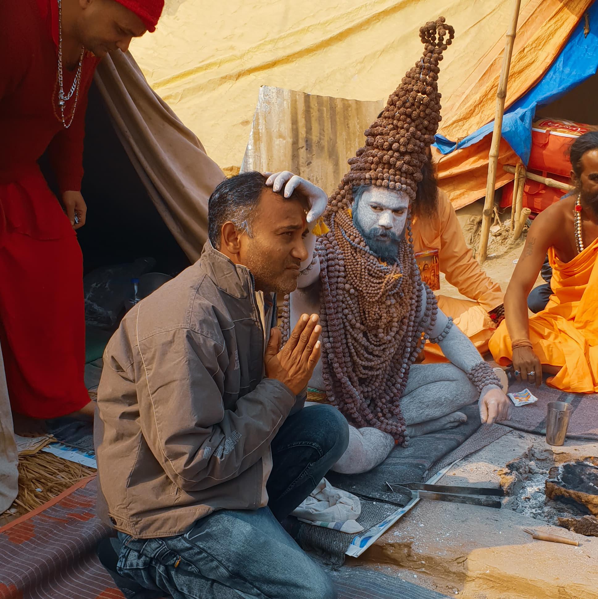 Naga Sadhu blessing Traveling honeybird
