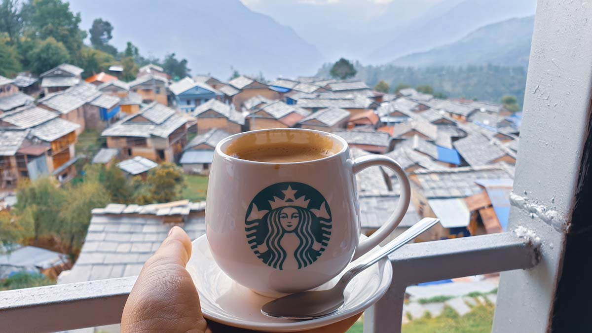 Coffee in a starbucks mug on Mohare Danda trek in Nepal